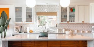 white-themed kitchen with pots mid-table