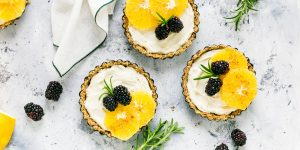 fruit tart s with rosemary and black raspberry toppings