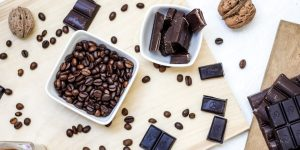 dark roast coffee beans with dark chocolates and walnuts