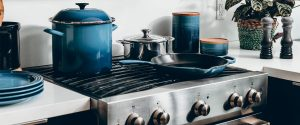 kitchen stove with pots and a saucepan