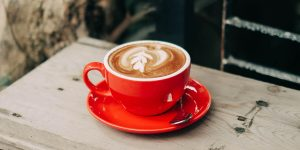 latte in a red ceramic cup with latte art