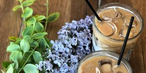 glasses of iced coffee with straws and flowers