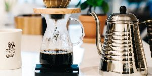pour over coffee maker in action and a kettle