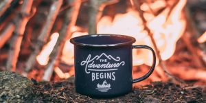 a cup with a bonfire background