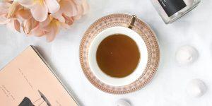 a cup of tea in a ceramic saucer