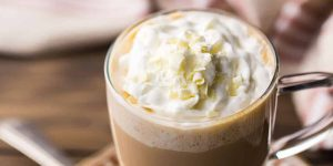 a mug of white chocolate mocha drink with whipped cream topping