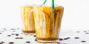 glasses of iced bourbon salted caramel latte coffee drink