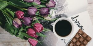 Coffee, chocolate and bouquet of tulip flowers