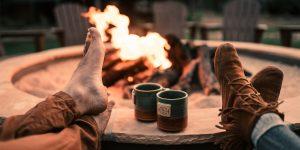 Drinking coffee beside a bonfire