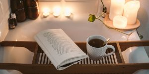 An open book and hot tea while in the tub