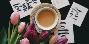 Regular coffee with tulip flowers