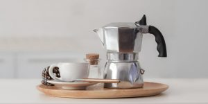 Coffee set containing coffee pitcher, cup and spoon