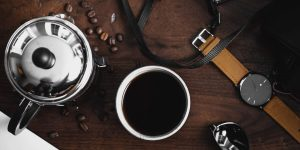Black coffee with watch and shades