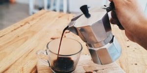 Pouring a newly brewed coffee