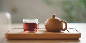 Tea on a mug and tea pot
