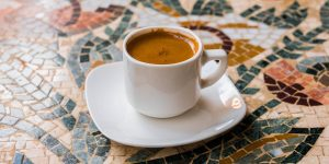 espresso in a white ceramic cup on a saucer