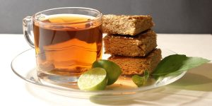 herbal tea with lime slices and butterscotch brownies