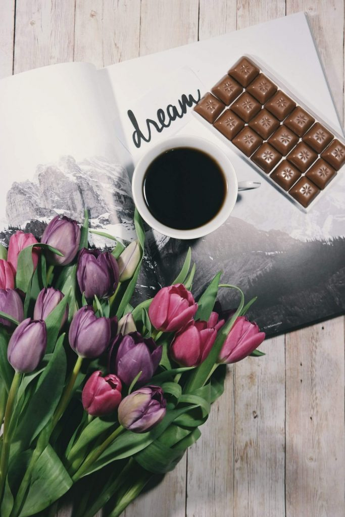 coffee with chocolates and a boquet of tulips
