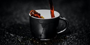 pouring coffee in a black cup