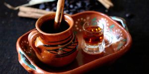 Woodened tea pitcher and wooden stick with a tea