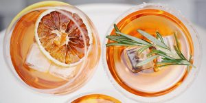 cocktail with rosemary and blood orange garnish