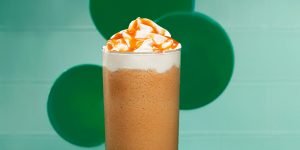 caramel frozem blended coffee with whipped cream and caramel syrup