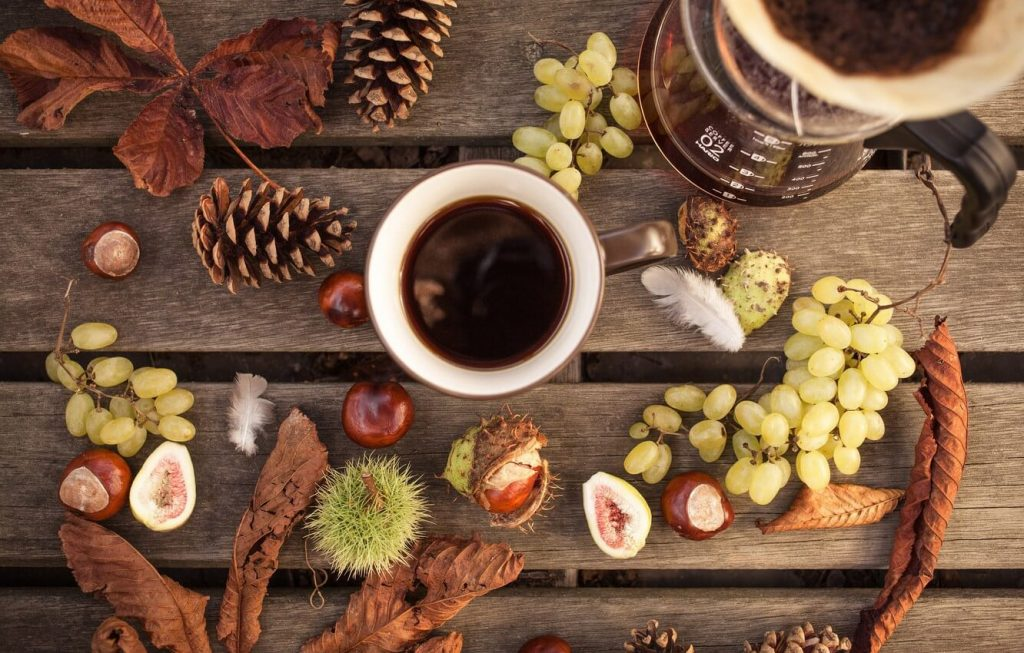 freshly brewed coffee surrounds with fruits