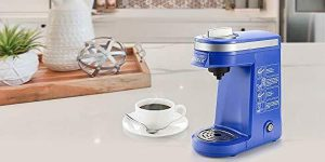 Coffee maker with a tea cup and saucer