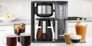 A coffee maker and 7 different kinds of coffee