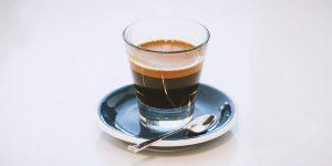 Espresso shot with a spoon