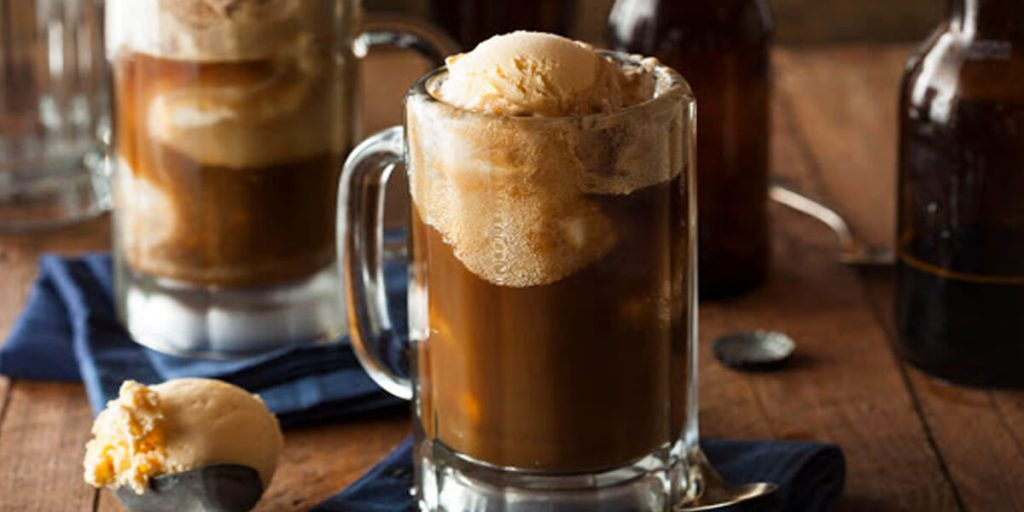 A chocolate drink with an ice cream on top