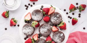 Cookies and strawberries in one plate