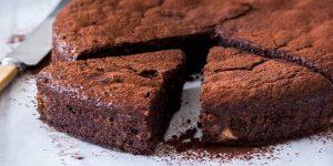 A sliced chocolate cake