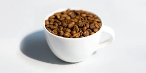Coffee beans on a white cup