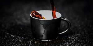 A black cup on a black background