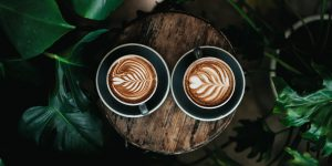Vintage tone cups of coffee with art